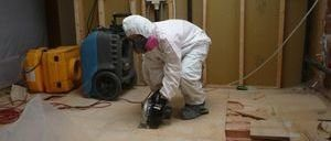 Technician Repairing Home After A Pipe Burst Disaster