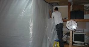 Mold Removal Tech Setting Up Vapor Barrier