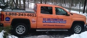 Water Damage and Mold Removal Truck On Residential Job Site