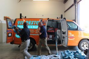 Technicians Preparing For A Fire Damage Restoration Job