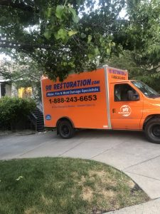 A Water Damage Cleanup Truck At A Residential Property