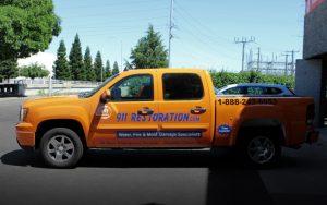 911-restoration-truck-side-view
